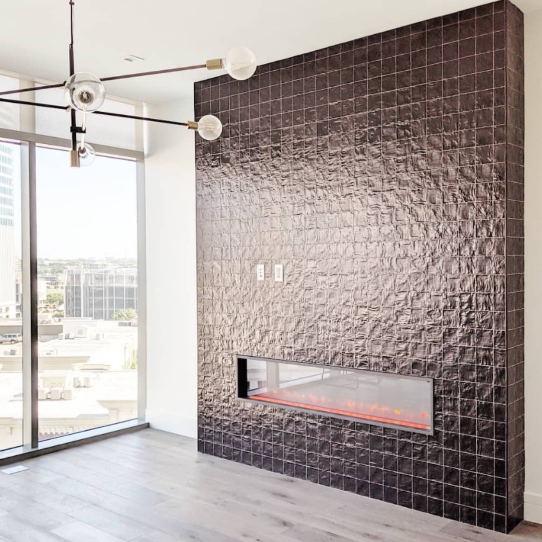 A modern fireplace with square black tile
