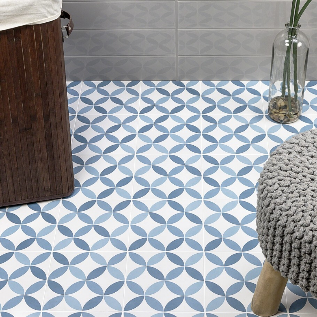 Blue patterned tile on floor with knitted stool