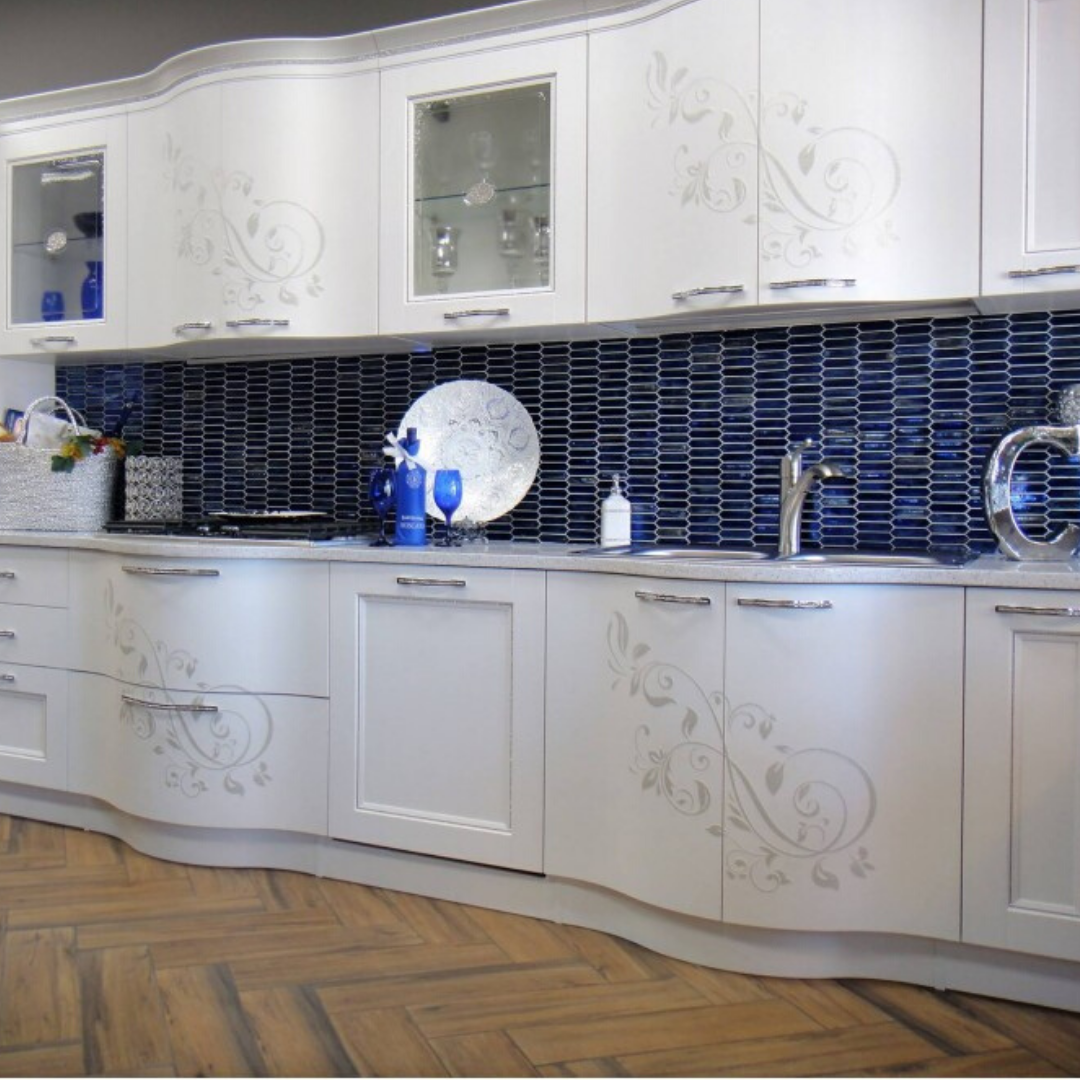 Gorgeous blue glass backsplash in ktichen.