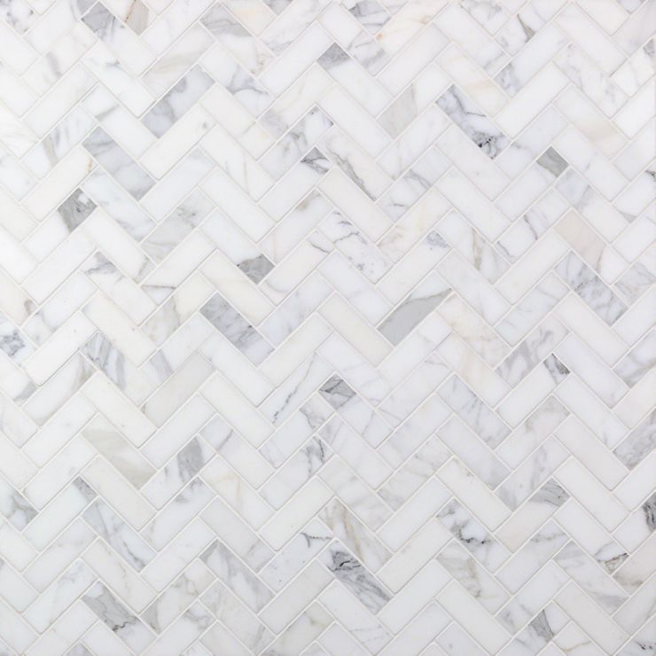 Calacatta Herringbone 1x3 Mosaic; in White w/ Gray & Gold Veins Calacatta; for Backsplash, Floor Tile, Wall Tile, Bathroom Floor, Bathroom Wall, Shower Wall, Shower Floor, Outdoor Wall, Commercial Floor; in Style Ideas Art Deco, Classic, Craftsman, Modern, Traditional