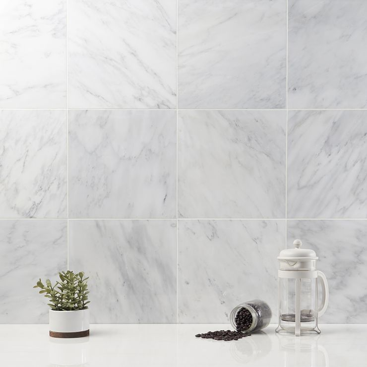 Asian Statuary 12X12 Polished Marble Tile; in White base with gray and gold veining Asian Statuary; for Backsplash, Floor Tile, Wall Tile, Bathroom Floor, Bathroom Wall, Shower Wall, Outdoor Wall, Commercial Floor; in Style Ideas Art Deco, Classic, Modern, Traditional